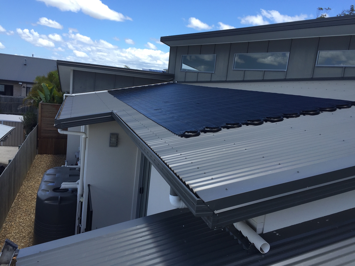 Solar pool heating panels on a roof